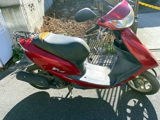 千葉県松戸市で無料で引き取り処分と廃車手続き代行をした原付バイクのホンダ Dio(BA-AF62) キャンディールーシッドレッド