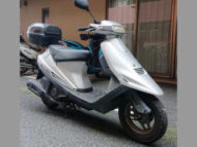 松戸市にある原付バイクのスズキ アドレスV100 シルバーを無料で引き取り処分と廃車手続き代行